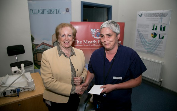 Mairead Shields, Chairman of The Meath Foundation presenting Ann Marie Barnes with her prize for the best poster presentation at the Meath Foundation / Tallaght Hospital Quality Improvement Day Friday 24th April 2015